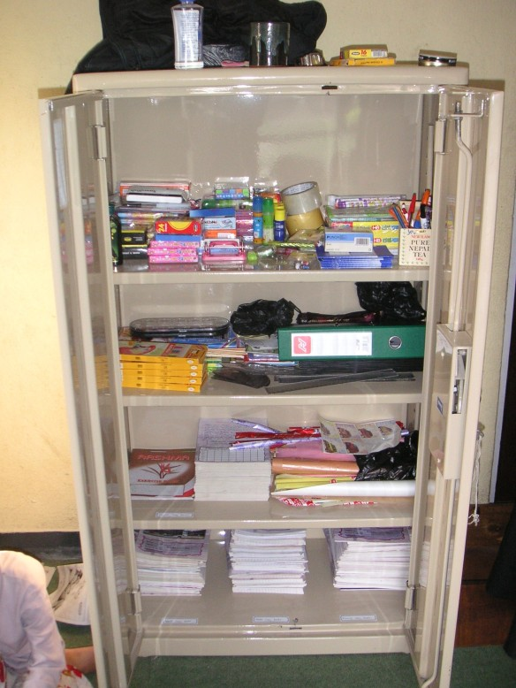 Our new cupboard filled with school supplies!