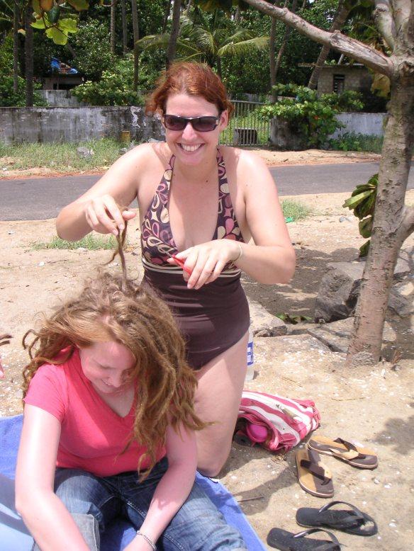 Cutting off this Swedish girl's dreadlocks on the beach, like you do....