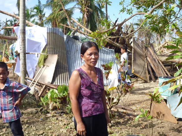 Mary-Ann Bantilan, in front of her makeshift shelter under the tree that fell on her house.